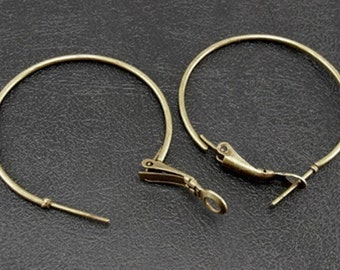 12 35mm antique brass hoop earrings with a spring clasp (6 pair)