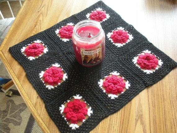 red rose on black table runner