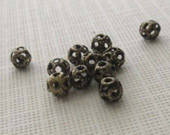 20 Antiqued brass 4mm round filagree beads