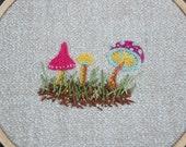 Polka-dot mushroom embroidered art