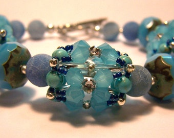Turquoise blue beadwoven beaded bead and gemstone bracelet