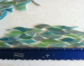 Green, purple, and aqua blended glass shards for mosaic art crafting