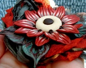 Rusty Red Flower on Leaves Necklace, hand sculpted, polymer clay