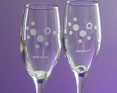 pair of etched ethanol molecule champagne glasses