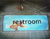 GOLDFISH restroom sign