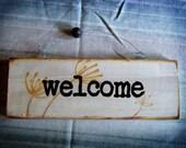 AMBER UMBELS welcome sign