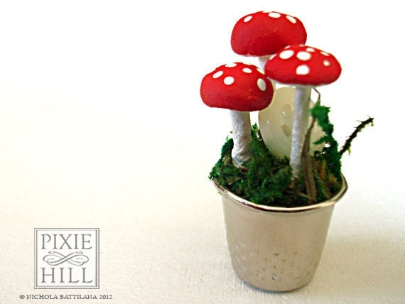 A Fairy Garden - Moss, Mushroom and Button Goodness in a thimble.