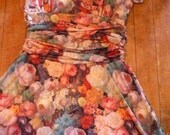 Beautiful Roses knit dress  stretches to fit many sizes bust 36