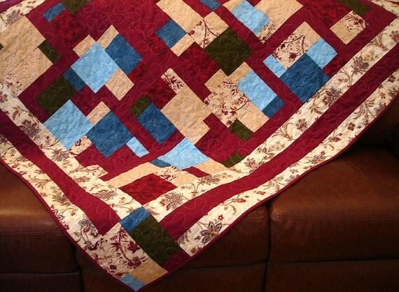 A Patchwork of Garnet Lap Quilt