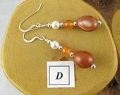 Sedona Sunset sterling silver french hook earrings featuring orange botswana agate MODEL D