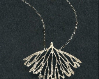 Hand etched sterling silver wing pendant