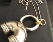 Pendant necklace with french horn piece