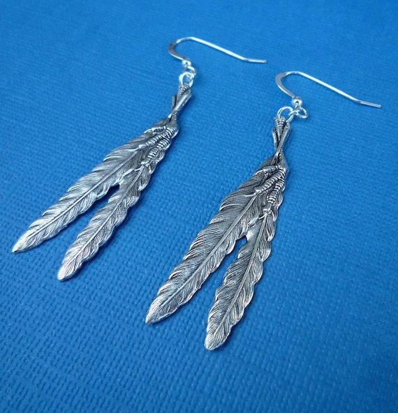 silver claw and feather earrings