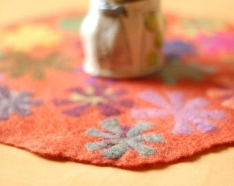 orange pin wheel round table runner