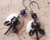 Iris ascendant earrings - gunmetal iris stampings on mother of pearl moons