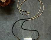 Etcetera Milky Quartz Necklace with Black, Silver and Gold Seed Beads