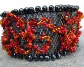 hana-bi-- black, red and orange beadwoven cuff bracelet