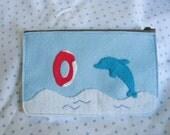 Light blue dolphin pouch