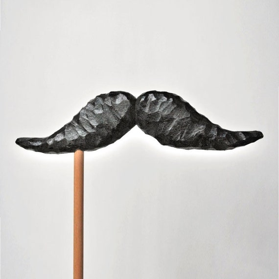 mustache on a stick. THE BANKER