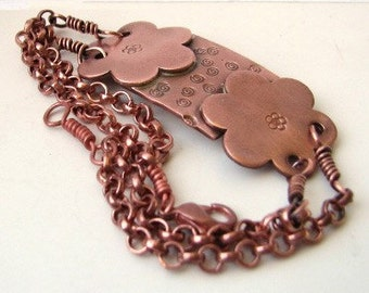 Copper stamped floral bracelet