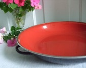 red and black enameled bowl