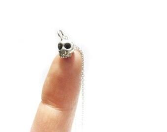 SALE extra small skull pendant