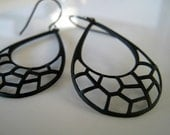 web - a lightweight and bold earring