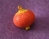 Plastic orange lantern charm