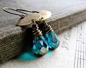 A N C I E N T. M E L O D Y... Blue mystic crystal and brass earrings