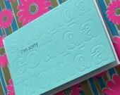 letterpress shoulda coulda woulda i'm sorry greeting card with subtle embossed words in background