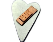 Sterling silver heart pendant with copper band aid