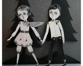 November and December articulated paper doll set with 10 silver brads