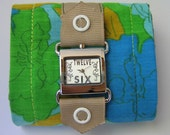 watch with tan ribbon