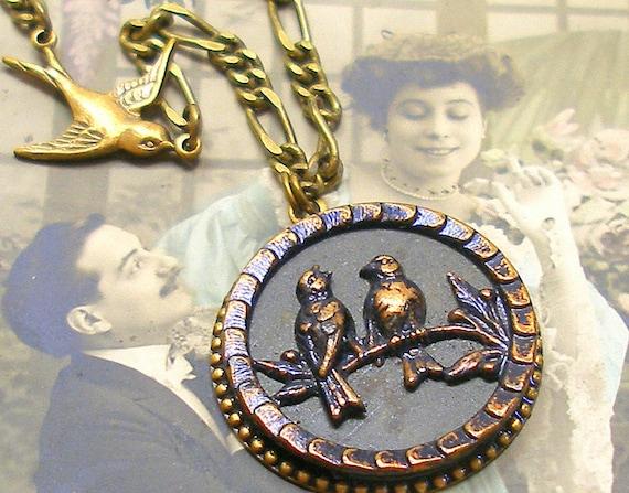 Song Birds Antique BUTTON necklace, 1800s Victorian Blue BIRDS on brass chain.