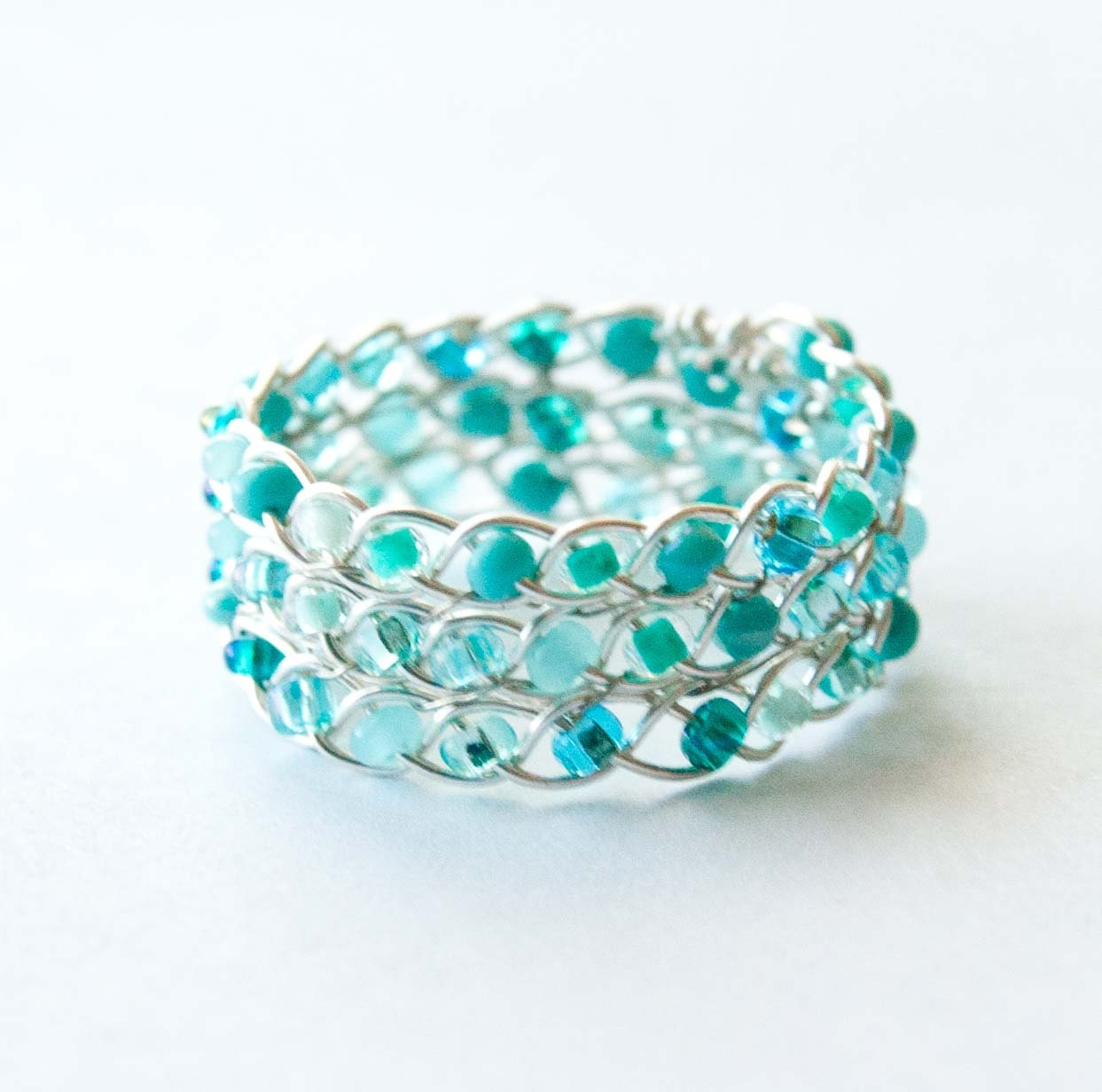 aqua and silver braided ring wire wrapped by hopefilledjewelry
