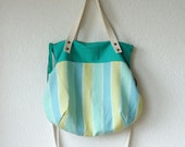 Aurelie Hobo Bag with Folded Top  and  Zipper Closure  in  European Linen Stripes in Turquoise
