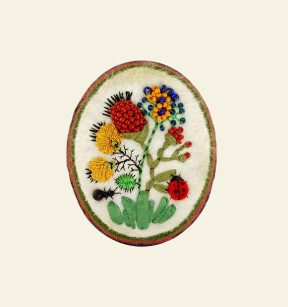 One of a kind embroidered cameo pin made out of wool felt, glass beads, silk ribbon and thread.