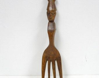 vintage hand carved wooden fork