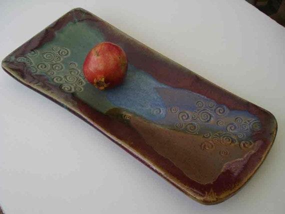Stoneware platter with spiral stamp design