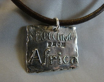 Africa necklace-Expecting from Africa-  on Leather