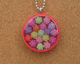 Eighteen - Plastic Bottle Cap and Resin Flower upcycled pendant
