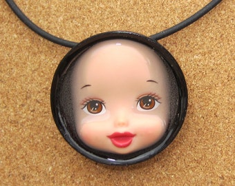 Sale item - Ruby Sue - upcycled doll face pendant