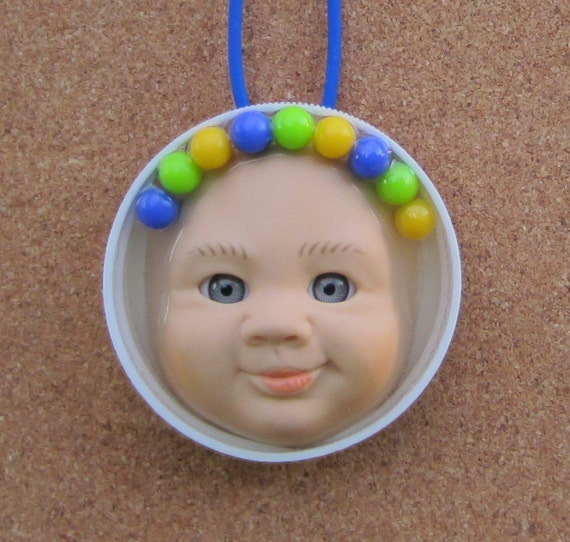 Circus Baby - Upcycled Plastic Bottle Cap Doll Face Pendant