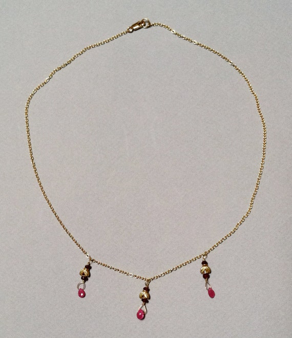 18k Gold Necklace adorned with Rubies and Sapphires