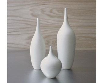 Trio of pure white ceramic bottle vases in modern matte white vessel bud vase by Sara  Paloma Pottery.  white vases mid century modern decor
