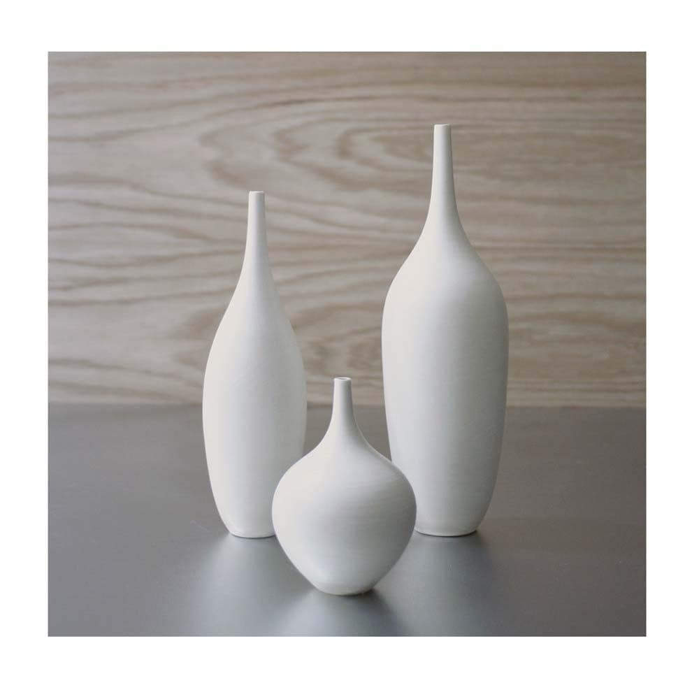 Trio of pure white ceramic bottle vases in modern matte white