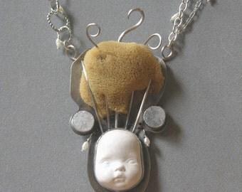 Brain Like A Sponge Doll Head Necklace