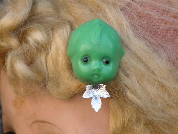 Green Doll Head With Leaf Brooch