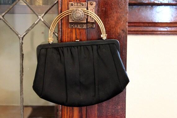 1940s black handbag with brass DECO handles