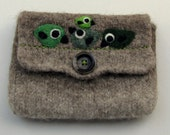 Pretty brown hand knit pouch purse cozy with four green birdies on wire